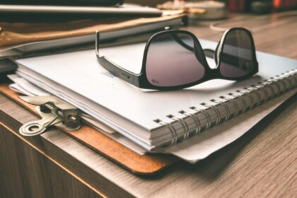 Clipboard and notepad for selecting a roof contractor
